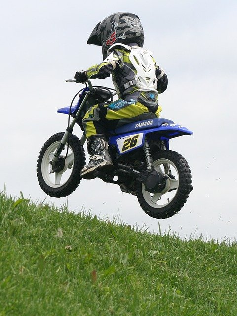 kid on motocross bike jumping with kids dirt bike boots